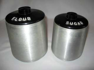 SPUN ALUMINUM 8 PIECE CANISTER SET WITH SALT AND PEPPER SHAKERS