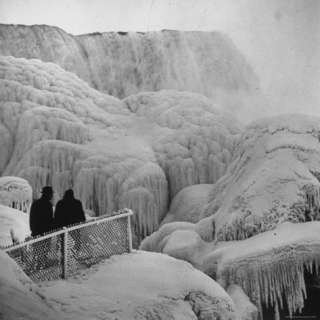 Frozen Niagara Falls, Trees, Park Grounds and Rocks Covered wi Ice