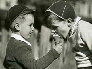 Two Boys Sharing Ice Cream Photographic Print by George Marks at