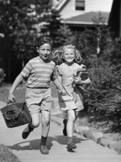 Boy and Girl Running With Books Photographic Print by George Marks at