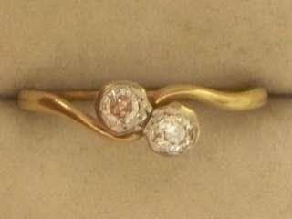 EDWARDIAN 18CT GOLD PLATINUM DIAMOND CROSS OVER RING