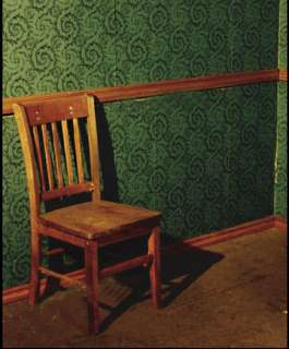 Solid wood chair slides and slams back and forth along a 5 wall