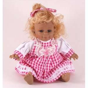 Small sized character doll   pink and white check dress   blond hair