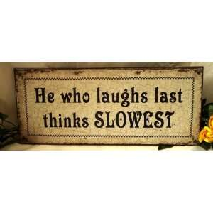 Weathered Tin Sign Laughs Last