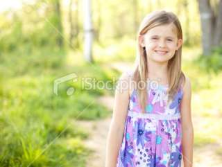Pretty 6 year old Girl Standing Outdoors Royalty Free Stock Photo